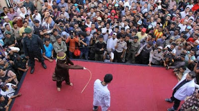 Publicly flogged for having gay sex in Indonesia's Aceh province