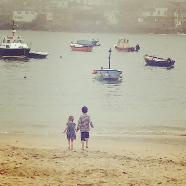 siblings holding hands on St Ives Beach
