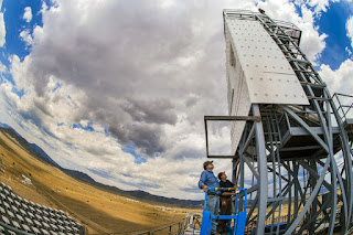 Technologists John Kelton and Daniel Ray inspect the falling-particle receiver at the National Solar Thermal Test Facility, operated by Sandia National Laboratories.