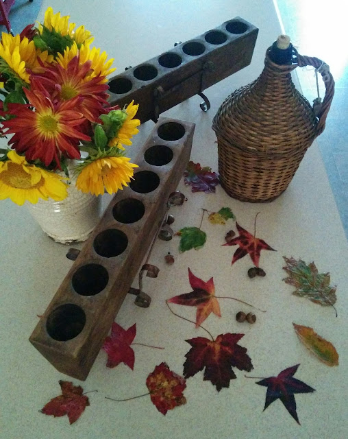Antique sugar molds and wicker demijohn