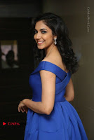 Actress Ritu Varma Pos in Blue Short Dress at Keshava Telugu Movie Audio Launch .COM 0056.jpg