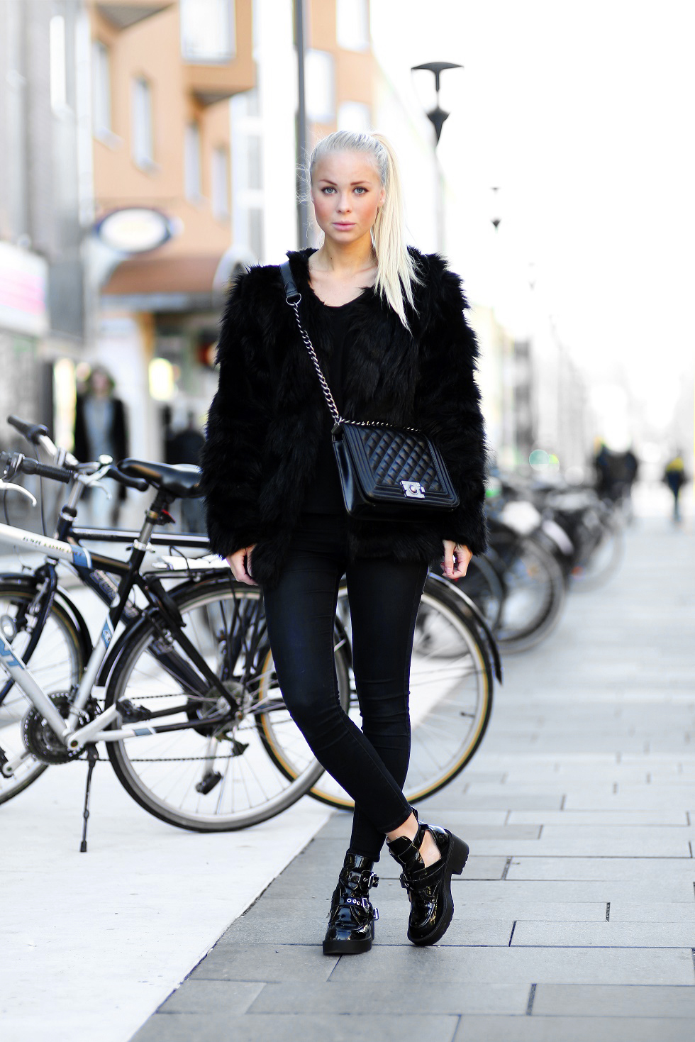 72a25a007790 Victoria Tornegren is wearing a black fluffy coat from Ch-icy.