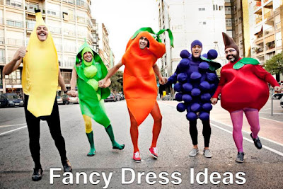 Stag group walking up the road hand in hand dressed as fruit