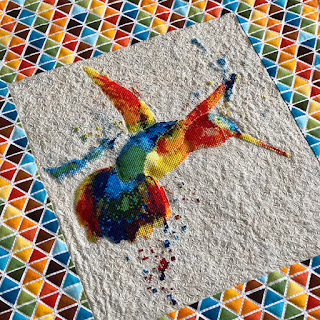 Cross stitched hummingbird with seed stitch background complete