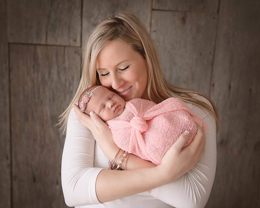 beautiful mother and newborn baby girl in DeKalb IL Newborn photography studio