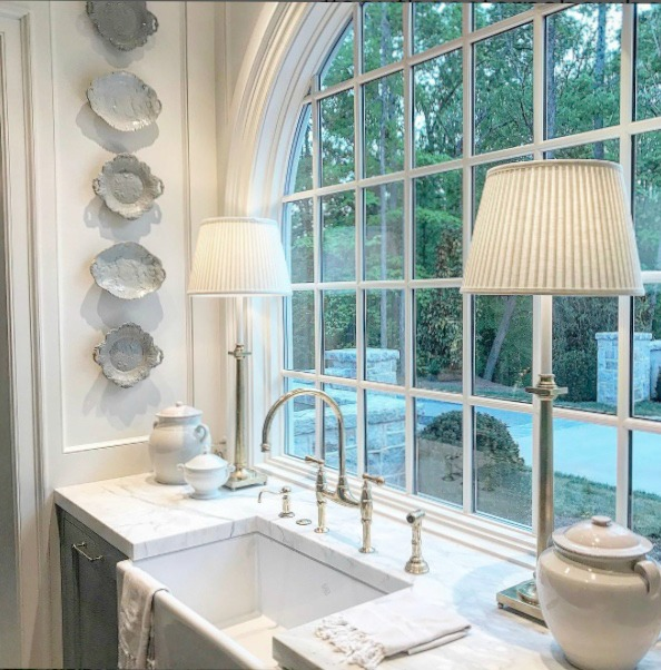 Farm sink with arch window in blue and white traditional kitchen in 2017 Southeastern Designer Showhouse in Atlanta.