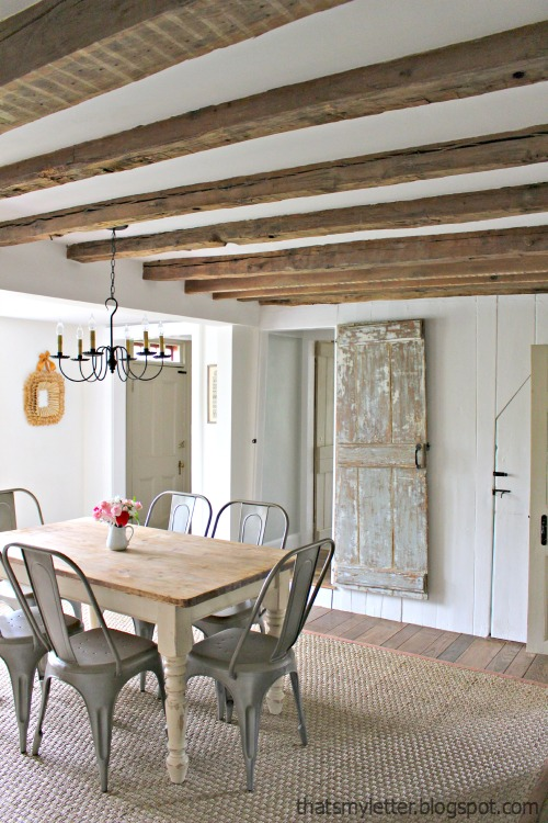 primitive home with exposed wood beam ceilings