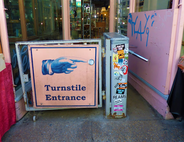 Turnstile entrance to an antique shop in The Laines, Brighton
