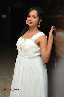 Actress Nakshatra Pictures in White Long Dress at Rojulu Marayi Movie Audio Release Function  0021.JPG