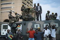 Civilians standing by members of the Zimbabwe Defense Forces in Harare