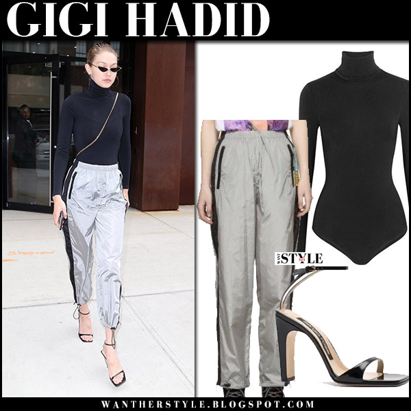 Gigi Hadid in black bodysuit wolford and silver track pants prada september 13 2017 new york fashion