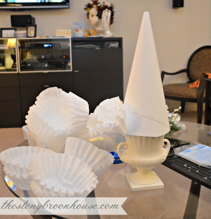 Gluing folded coffee filters onto cone