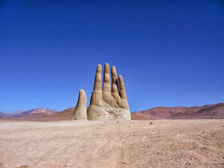 """The Hand of the Desert"", Atacama, Chile giant fingers, as if to dig out the sand of the desert, to allow the body to get the rest (based on the size of the hand, it must be a real giant), invented and brought to life by the Chilean sculptor Mario Irarrasabal."
