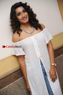 Kannada Model Actress Krishi Thapanda Stills in Ripped Jeans at Eradu Kanasu Movie Press Meet  0003.jpg
