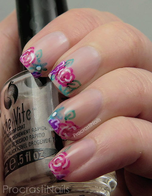 Floral nail art done with negative space and flowers drawn with sharpie markers