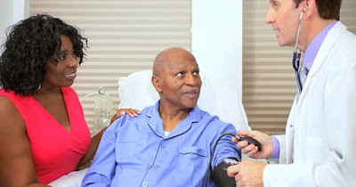Black man in hospital with high blood pressure