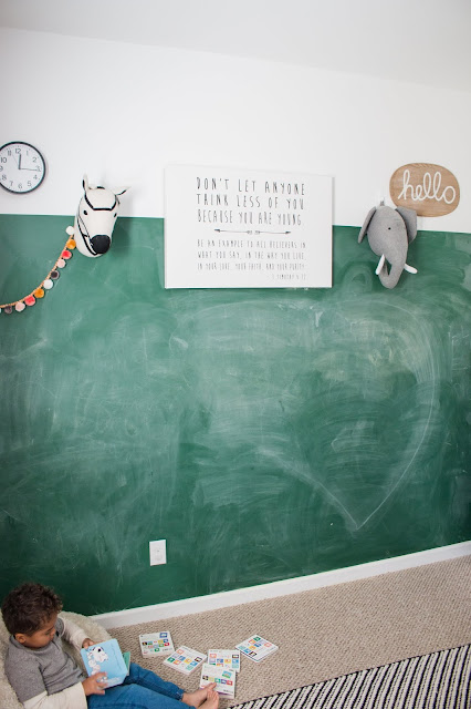 green chalkboard wall in a playroom