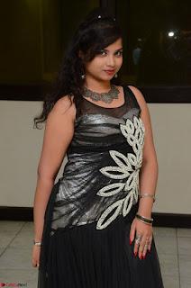 Shrisha Dasari in Sleeveless Short Black Dress At Follow Follow U Audio Launch 059.JPG