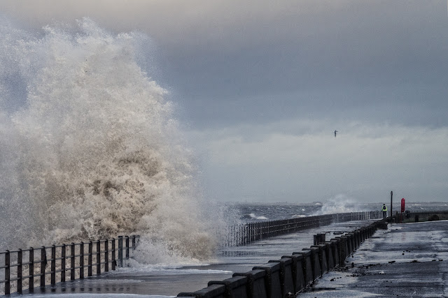 Photo of a towering wave spinning its way along the Promenade
