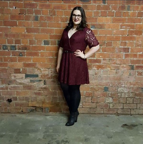New Look maroon wrap dress against brick wall