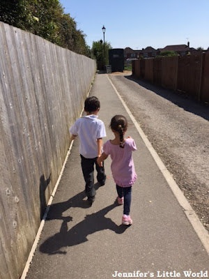 Children walking down footpath together