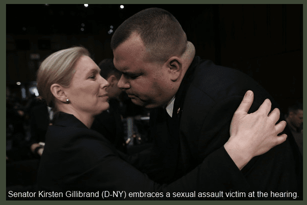 Sen. Kirsten Gillibrand (D-NY) embraces a victim of sexual assault in the US military