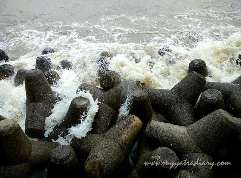 Waves crashing on the rocks at Marine Drive, Mumbai