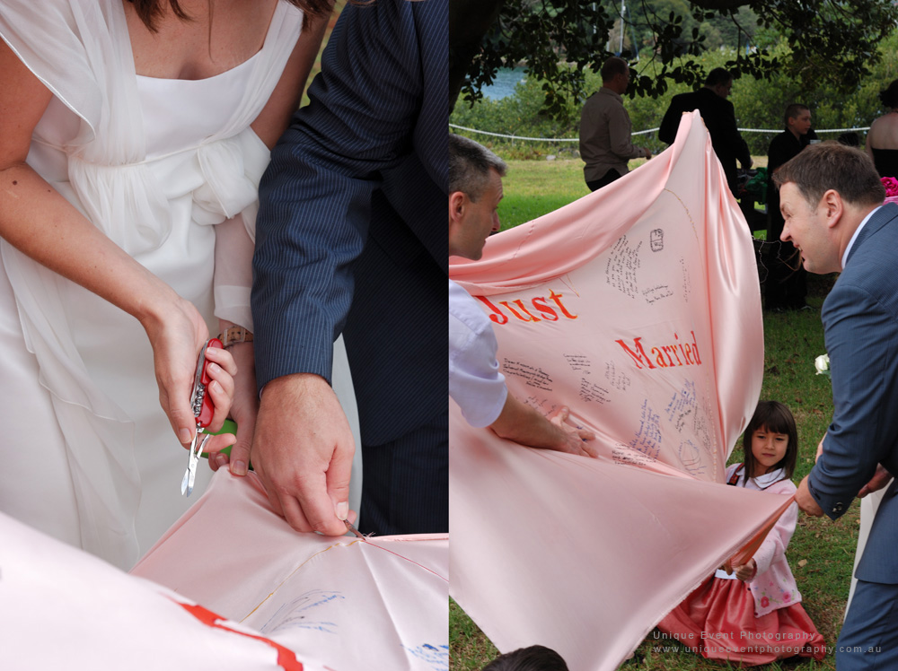 Cutting the Swiss Heart together as husband and wife, Garden Wedding Photographer Sydney,