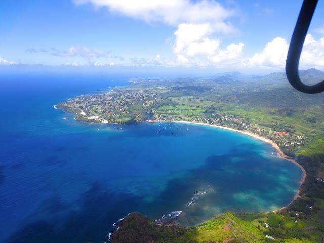 north shore kauai ocean cove beach water coastline aerial view helicopter
