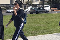 Charlize Theron Spotted Walking On Sea Point Promenade In Cape Town! (Photos)