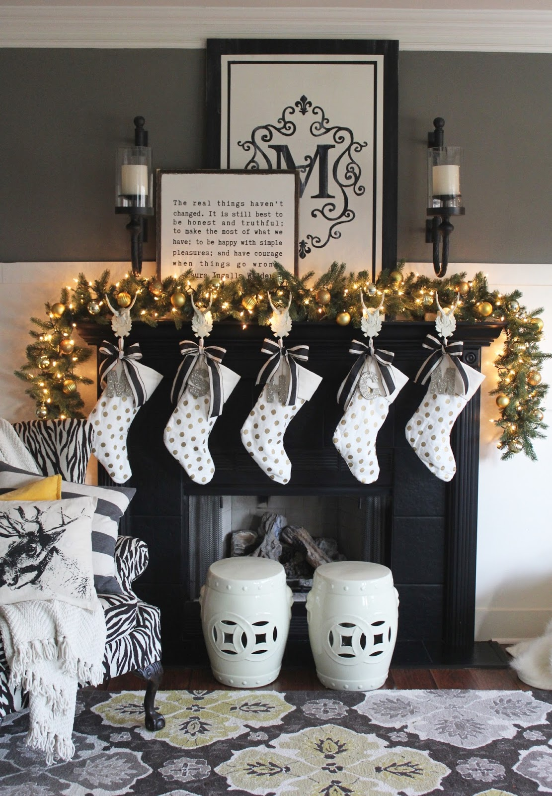 the yellow cape cod 2016 holiday home tour ballard designs antler stocking holders i love the way these white elements pop against my black painted fireplace i added german glass monogram tags