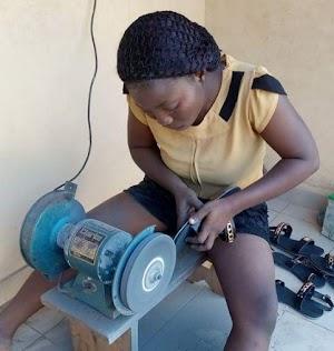 Meet A Female Graduate of Ekiti State University Making Shoes To Survives