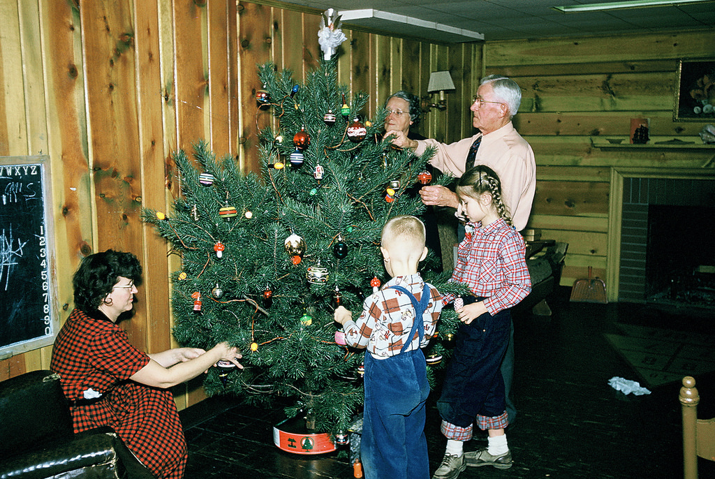 preparing for christmas 37 lovely vintage photos show people decorating their christmas trees vintage everyday - People Decorating A Christmas Tree