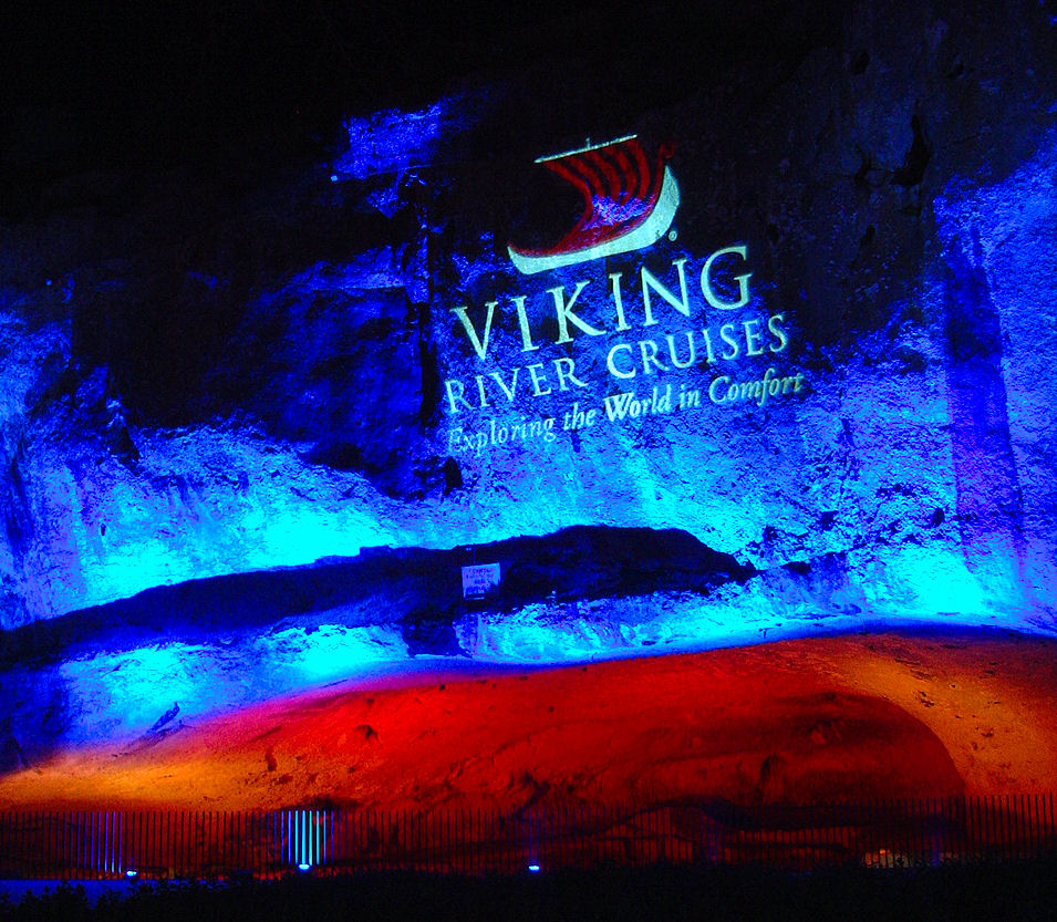 Viking River Cruises logo projected above an ancient grotto at le Pont du Gard.