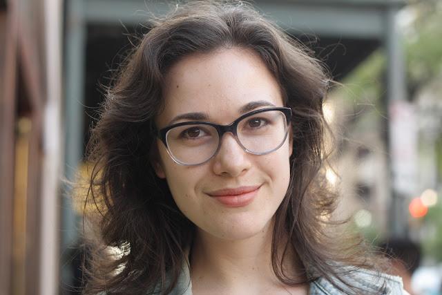 brunette girl with glasses