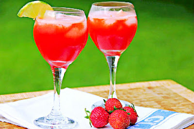 2 wine glasses filled with strawberry aqua fresca