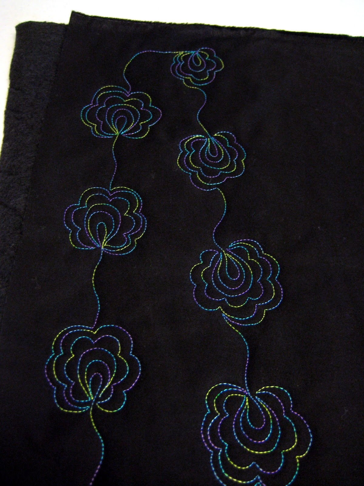 Linear scroll flowers
