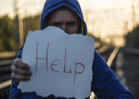 A desperate man asking for help.