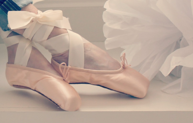 Michele of Hello Lovely Studio in pink pointe shoes with ribbons