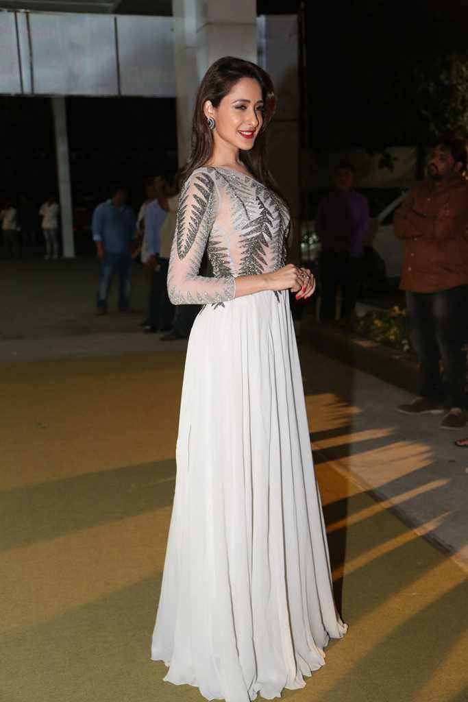 Pragya Jaiswal Hot Photos In White Dress At Movie Audio Launch