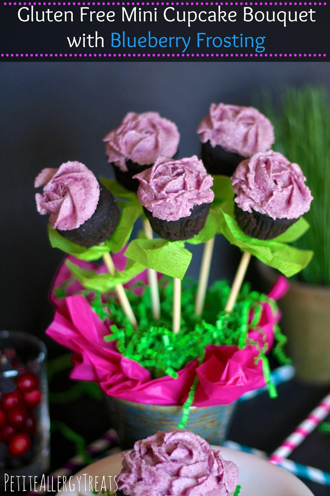 a bouquet of mini cupcakes decorated like flowers with blueberry frosting