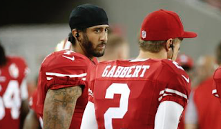 Colin Kaepernick Will Continue To Sit Through National Anthem Until There's 'Change'