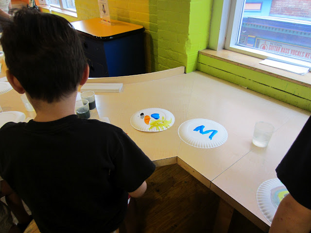 Painting Station at the Crayola Experience