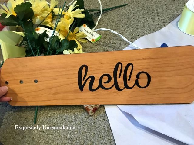 Fan Blade with hello stenciled on it