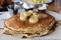 '77 Elvis Pancakes: Chocolate Chip Pancakes, Banana Compote, Bourbon Maple Syrup, Peanut Butter at Yardbird Southern Table & Bar