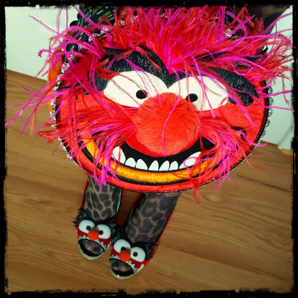 holding Irregular Choice Muppets Animal bag wearing animal red fur shoes