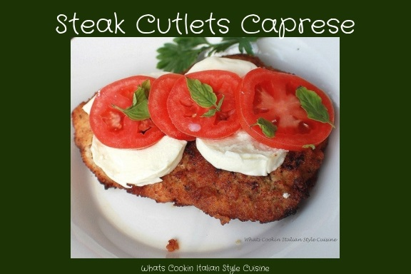 Fried steak cutlets with mozzarella, fresh basil and tomatoes
