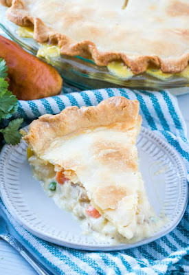 slice of creamy chicken pot pie on a plate