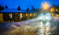 Flooding in Straiton, Scotland, in December. Scientists say it will increase in future. (Photograph Credit: Danny Lawson/PA) Click to Enlarge.