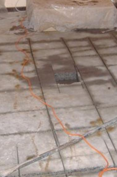 Rebar doweling required for a insufficient reinforced distressed slab foundation cut over footing support